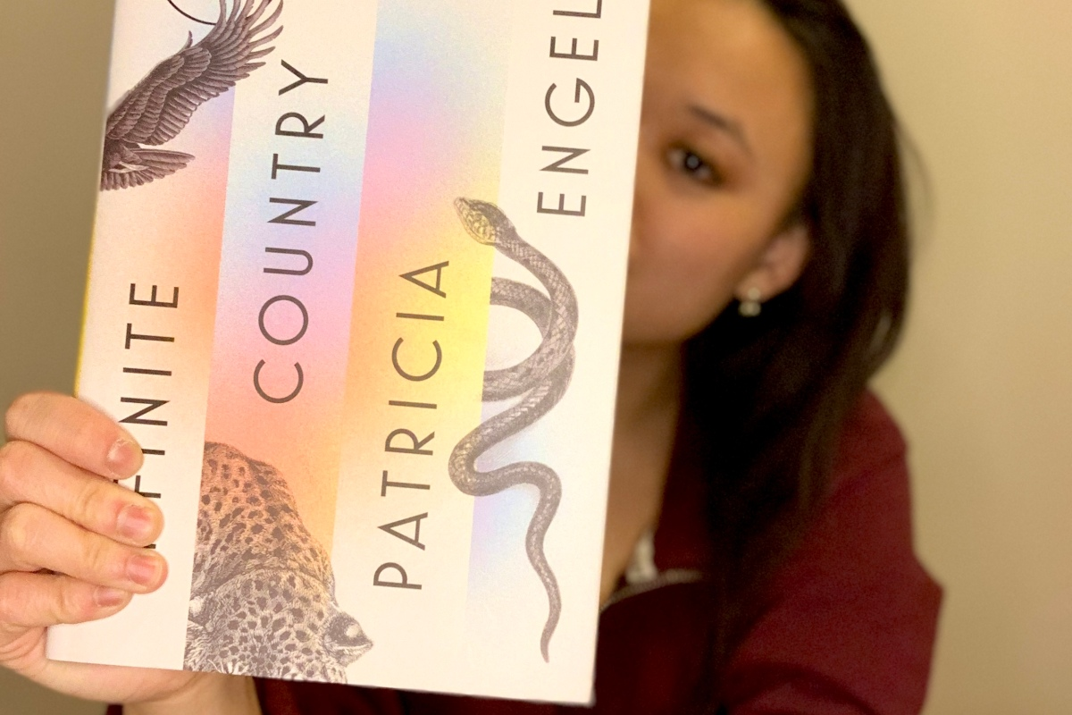 I'm holding Infinite Country by Patricia Engel in front of my face.